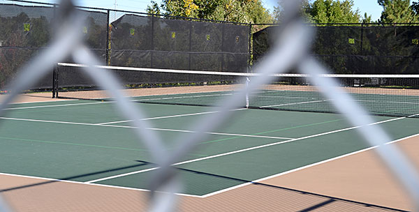 Tennis Courts Through the Fence Photo